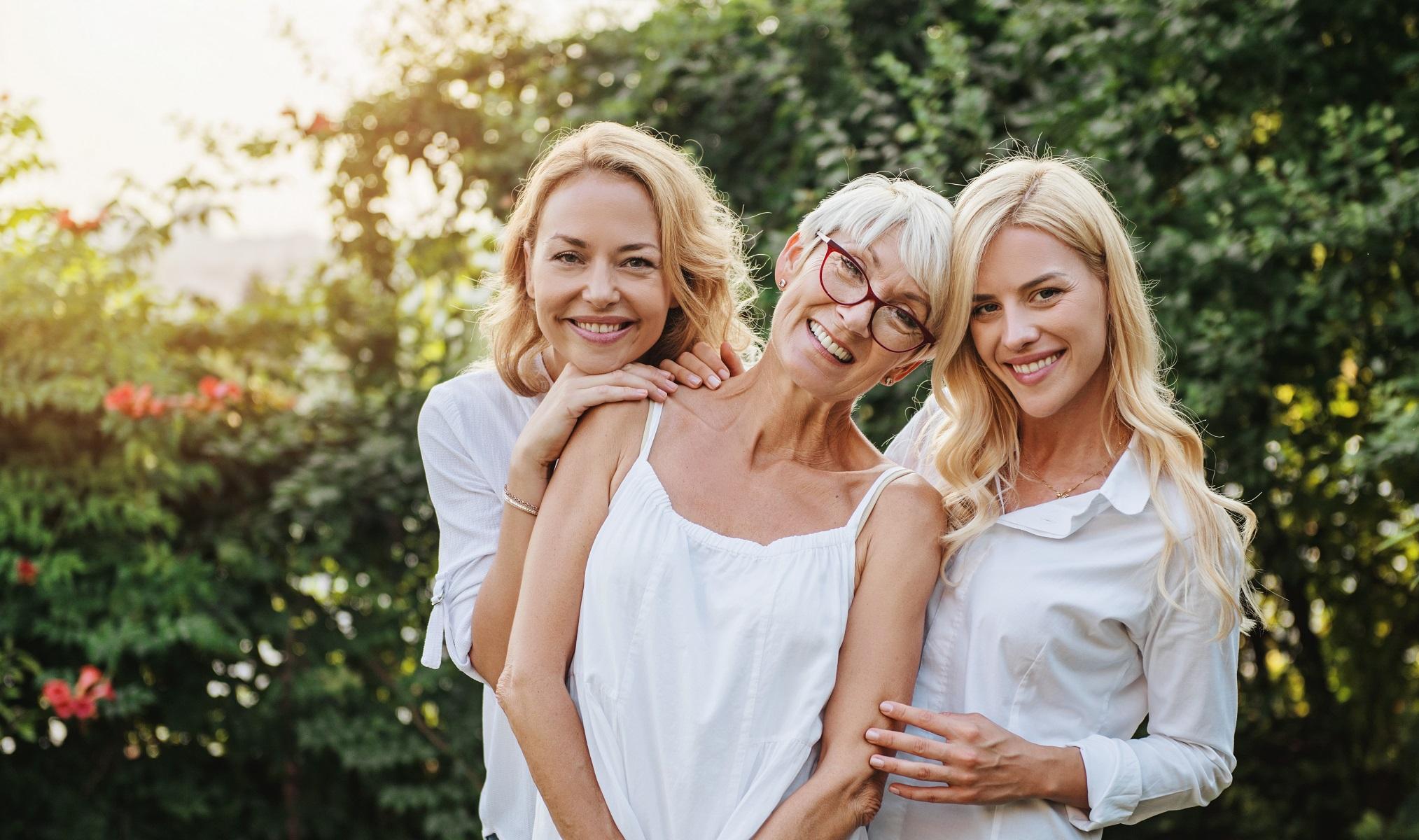 Three women enjoying outdoors talking and laughing